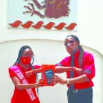 St. George Parish Independence Ambassador Leah Bascombe, at left, giving the tablet to the Acting Principal of The Lodge School, Robin Douglas