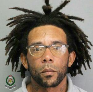 <strong>Steven Belle</strong> is approximately 5ft 7 inches tall, slim built and of a light brown complexion. He has an oval-shaped face, protruding ears, wide-set eyes and wears spectacles. Belle has a dreadlocks hairstyle along with a one-inch slanted scar in the centre of his forehead.
