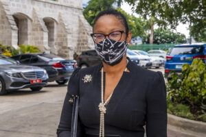 Sen Lisa Cummins, Min of Tourism in a less flamboyant mask for the mourning procedure
