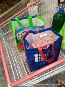 Massy and iMart shopping bags in trolley
