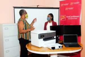 Deputy Principal Juliette Cumberbatch explains how the equipment will be used to Samantha Suttle Marketing Manager Barbados OpCo immediately following the presentation at the Cane Field location