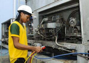 Nicholas Lampkin as he works on some of the refrigeration equipment at HIPAC