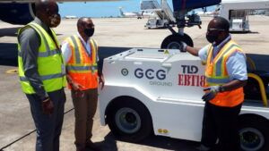 Renee Reid (left) shows GAIA CEO Hadley Bourne and GCG Station Manager Brian Reid how the electric tractor works