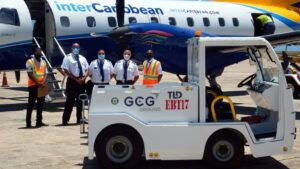GCG Ops Team Member Ryan Butcher and Station Manager Brian Reid (in safety jackets) flanking members of the interscaribbean flight crew. One of the machines is in the foreground