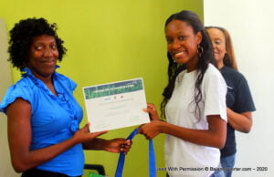Founder of The Deaf Heart Project and reigning Miss World Barbados, Ms. Ché Greenidge presenting certificate to deaf participant, Suanna Marshall.