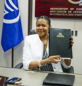 """This signing made The UWI a Social Partner of the ACS. Expounding on the significance, ACS Secretary General <strong>Dr. June Soomer</strong> said: """"<em>As the 13th Social Actor within the ACS, you will be engaging with an organisation that was established in 1994, at the height of the decolonisation process. It was an organisation that CARICOM agreed should be formed as we made our way into the world</em>."""""""
