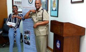From left Shante` Thompson and Acting Commissioner Erwin Boyce.