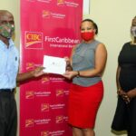 Chief Executive Officer and Founder of Gospel Street Ministry, Steve Skeete, left, receives a donation for the Ministry from Managing Director, Barbados & the OECS, Donna Wellington; Michelle Whitelaw, Director Retail Banking Channels, right, witnesses the presentation.