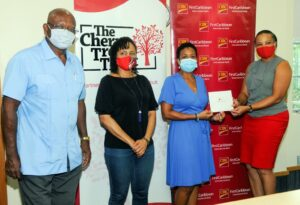 CIBC FirstCaribbean, Managing Director, Barbados & the OECS, Donna Wellington, right, presents the sponsorship cheque to Board Member and Trustee of The Cherry Tree Trust, Renee Kowlessar, second from right; also, in the picture are from left, The Trust's General Manager for Beneficiaries Services Ezlon Griffith and the Trust's most recent beneficiary and entrepreneur, Charmaine London