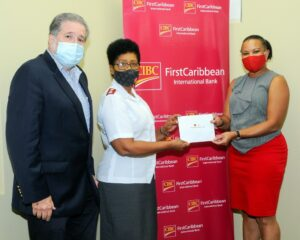 Managing Director, Barbados & the OECS, Donna Wellington, right, presents the Salvation Army with a donation which is received by Divisional Commander for Barbados and St. Lucia, Brenda Greenidge. Advisory Board Chairman (Barbados), Paul Bernstein looks on.