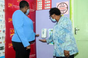 Glendene Hayde (right) tests the newly installed hand sanitiser with Michellle Whitelaw ((left) in one of the Infants' classrooms
