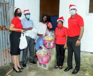 Andre Headley who was painting the house when the GEL team visited, expressed thanks and received the items on behalf of his family which comprises eight (8) children including two (2) sets of twins. Headley (sitting centre) accepts the hamper items from the team - from left Gillian Smith, Ricardo Whittaker, Vonita Padmore and Anthony Ali.