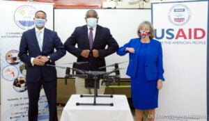 USAID Eastern and Southern Caribbean Regional Representative Clinton White, CIMH Principal Dr. David Farrell, and U.S. Ambassador Linda Taglialatela celebrate strengthened regional disaster and climate variability prediction and response capacity enabled by five new drones delivered to CIMH by USAID.