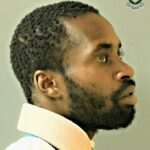 Damian Hunte is 5 feet 8 inches tall, dark complexion and of slim build. He has a broad nose, normal ears, broad mouth and thick lips.