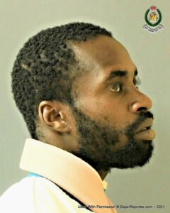 <strong>Damian Hunte</strong> is 5 feet 8 inches tall, dark complexion and of slim build. He has a broad nose, normal ears, broad mouth and thick lips.