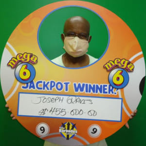 Joseph Davis celebrates his 455000 jackpot win in The Barbados Lotterys Mega 6 game. He previously won 270000 with Double Draw.