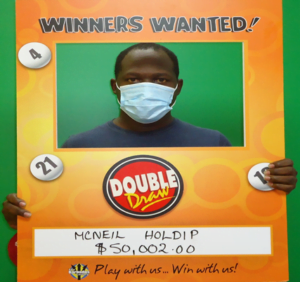 McNeil Holdip displays his win of 50002 in The Barbados Lotterys Double Draw game.