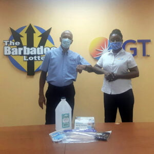 Cheryl Hoyte Khan, Customer Service Supervisor (right) of The Barbados Lottery displays some of the PPEs and sanitary supplies recently donated to Cally Boyea, President, The Barbados Diabetes Foundation.