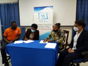 (L-R) NCSA Deputy Chairman Troy Wickham, NCSA Manager Mrs. Betty Hunte, Assistant Vice President of ICT Services Mrs. Cheri-Ann Sealy Catwell, and Change and Project Manager of the PBS Technologies, Ms. Shontelle Bryan during the signing of the contract.