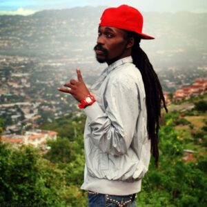 """<strong>Munga Honorable</strong> adds much heat to the already hot track with his contribution, which rounds up the song. Known for popular tracks such as """"<em>Bad from Mi Born</em>"""" and """"<em>Nah Mad</em>"""", he started out in Dancehall when he entered the Red Label Wine Superstar Competition in 1997. He moved on opening for firebrand act Capleton, whom he cites as one of his mentors and is now a popular figure in Dancehall."""