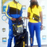 (Left – right) Displaying the Barbados Olympic team gear are Mario Burke, Tokyo 2020 Olympic Games qualifier for the 100M & 200M and Kendia Brathwaite, Programme Officer, BOA
