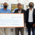(Left – right) Shelly Ann Hee Chung, General Manager, IGT and Ferdinand Lord, Site Operations Manager, The Barbados Lottery present a cheque for the Barbados Olympic team to Cameron Burke, Vice President, Barbados Olympic Association (BOA) & Tokyo 2020 Chef de Mission, Anicia Wood, Chair, Barbados Athletes Commission and Erskine Simmons, Secretary General, BOA.